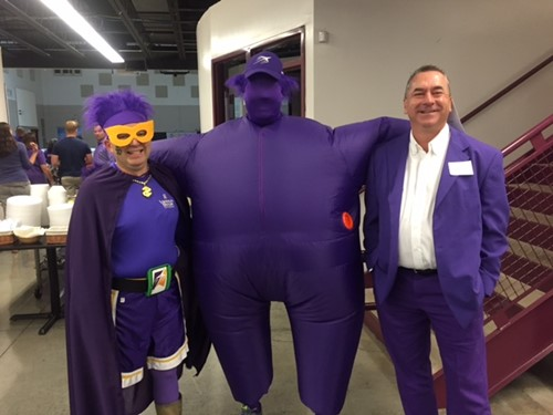 Staff Kicks Off New Year by Painting it Purple
